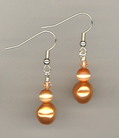 orange pearl cat's eye crystal earrings