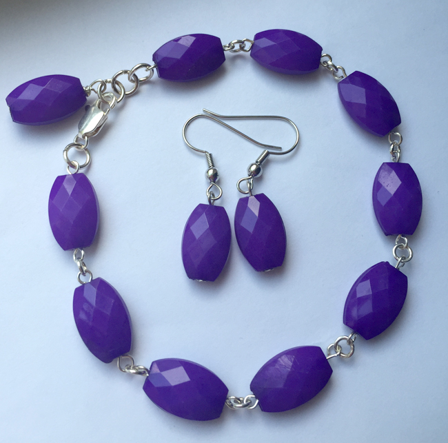 "Beautiful Purple grape faceted beads hand linked with silver artisan wire for the perfect dangle bracelet. An easy to wear 8"" with a couple of links for adjustments. Perfect to add to your arm candy when you stack them up!   The matching 3/4"" earrings on silver nickle-free hypoallergenic ear wires are lightweight and easy to wear.  So fun and affordable."