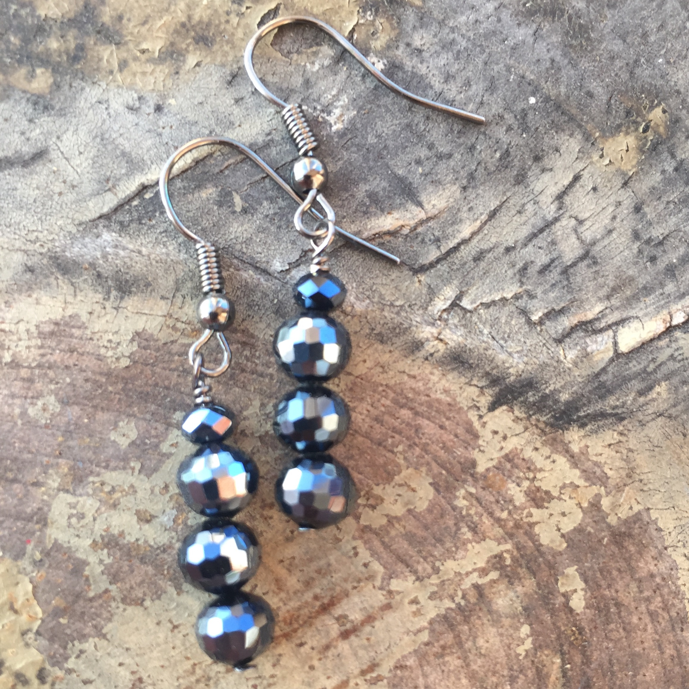 jet black round crystal stack NF earrings